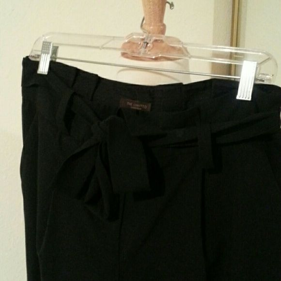 Limited high waist slack with tie belt So super trendy with the high waist and loose fit.  Straight loose legs and cuffed bottom hems.  Belt is removable and can be tied in various ways.  Pleats and pockets make these pants fun.  31 inch inseam.    No wear or tear.  Excellent condition. The Limited Pants Trousers
