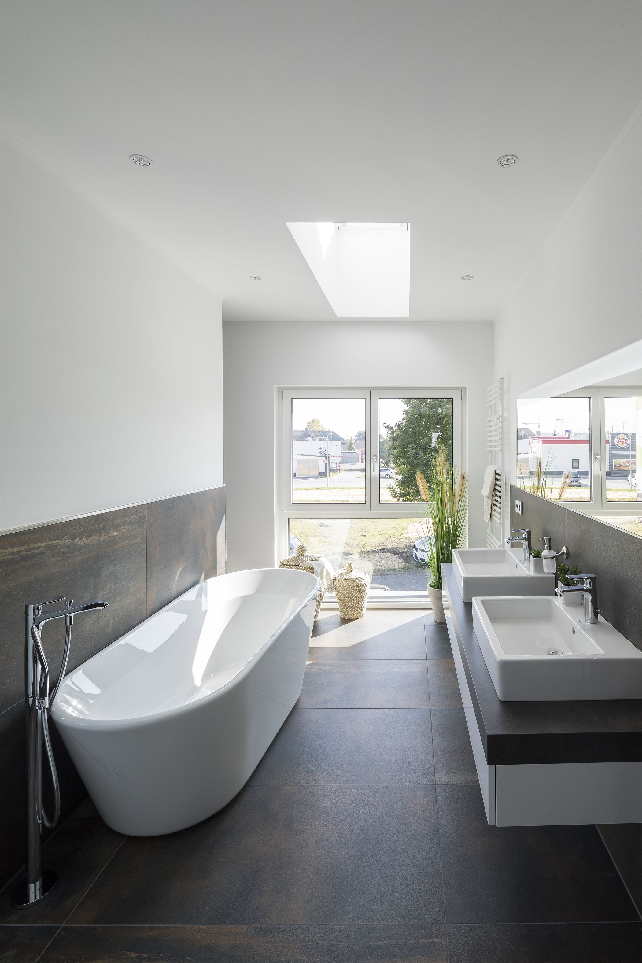 7 Stunning Home Extension Ideas: Stunning Home Extension With Roof Windows In The Bathroom. Bright White Bathroom With Roof