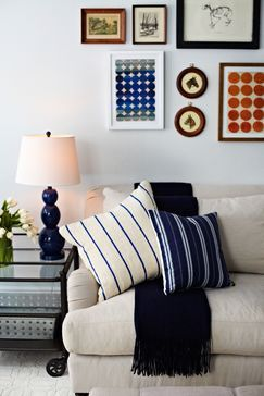 Detail of living room side tables. Blue glass lamps and white tulips. Photography by Jacob Snavely · See more at httpchangoandco.comportfolio55-central-park-west