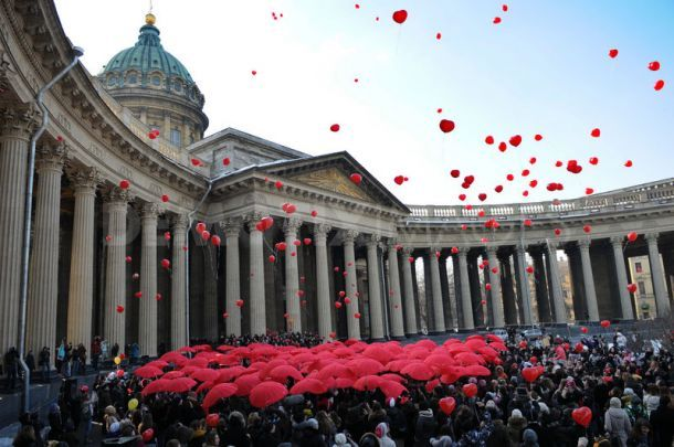 A flashmob saw hundreds of young women carrying heart-shaped umbrellas gather in St Petersburg, Russia, to celebrate International Women's Day.