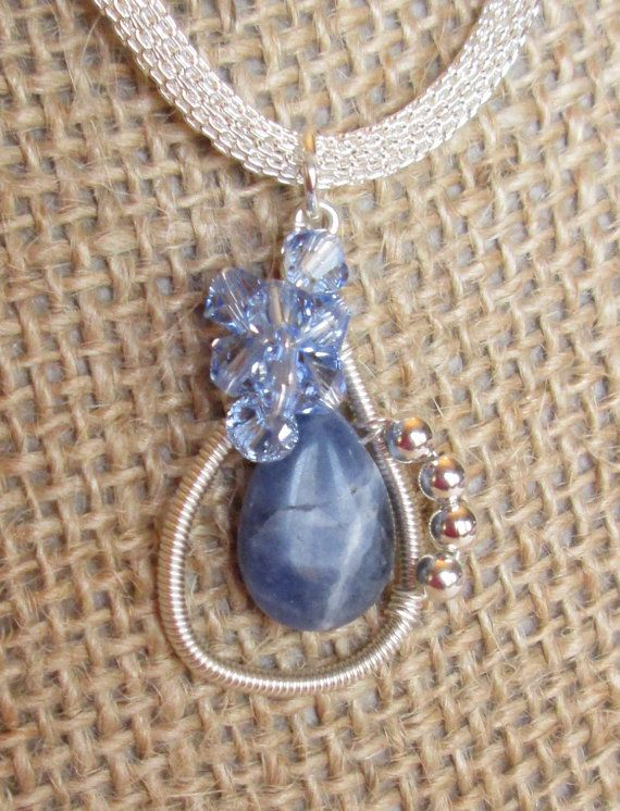 My maxim: More is More Wire Wrapped Pendant Swarovski and Sodalite by HandMadeBySunshine