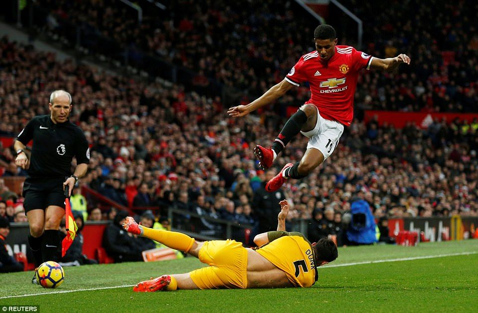 Manchester United striker Marcus Rashford is forced to