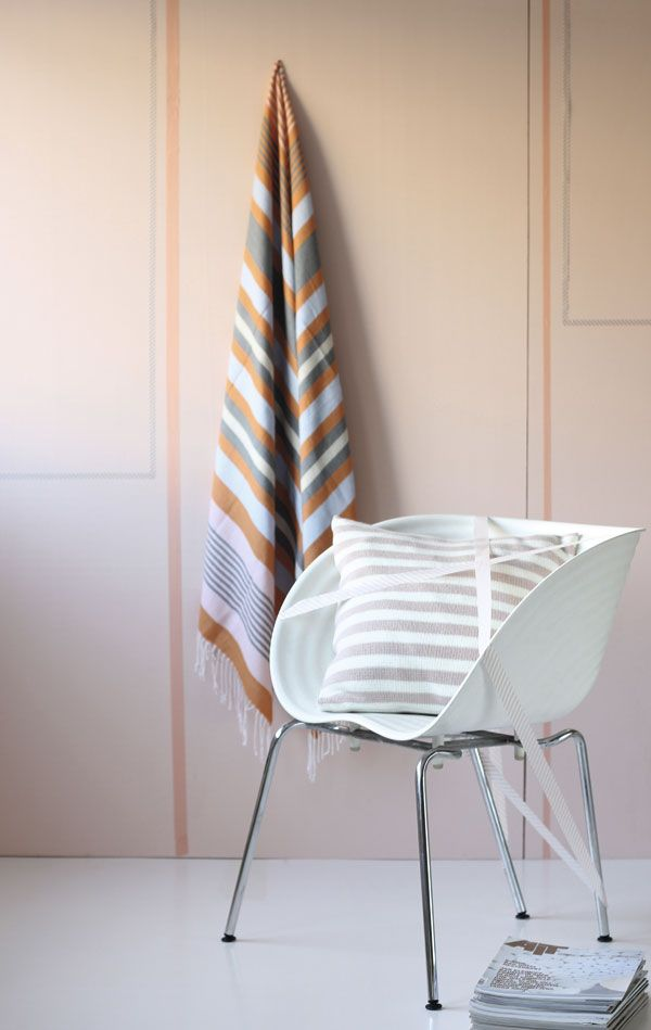 Plastic Chair Tom Vac from Vitra with striped knit pillow from the box.  Blankets / scarf from H & M.