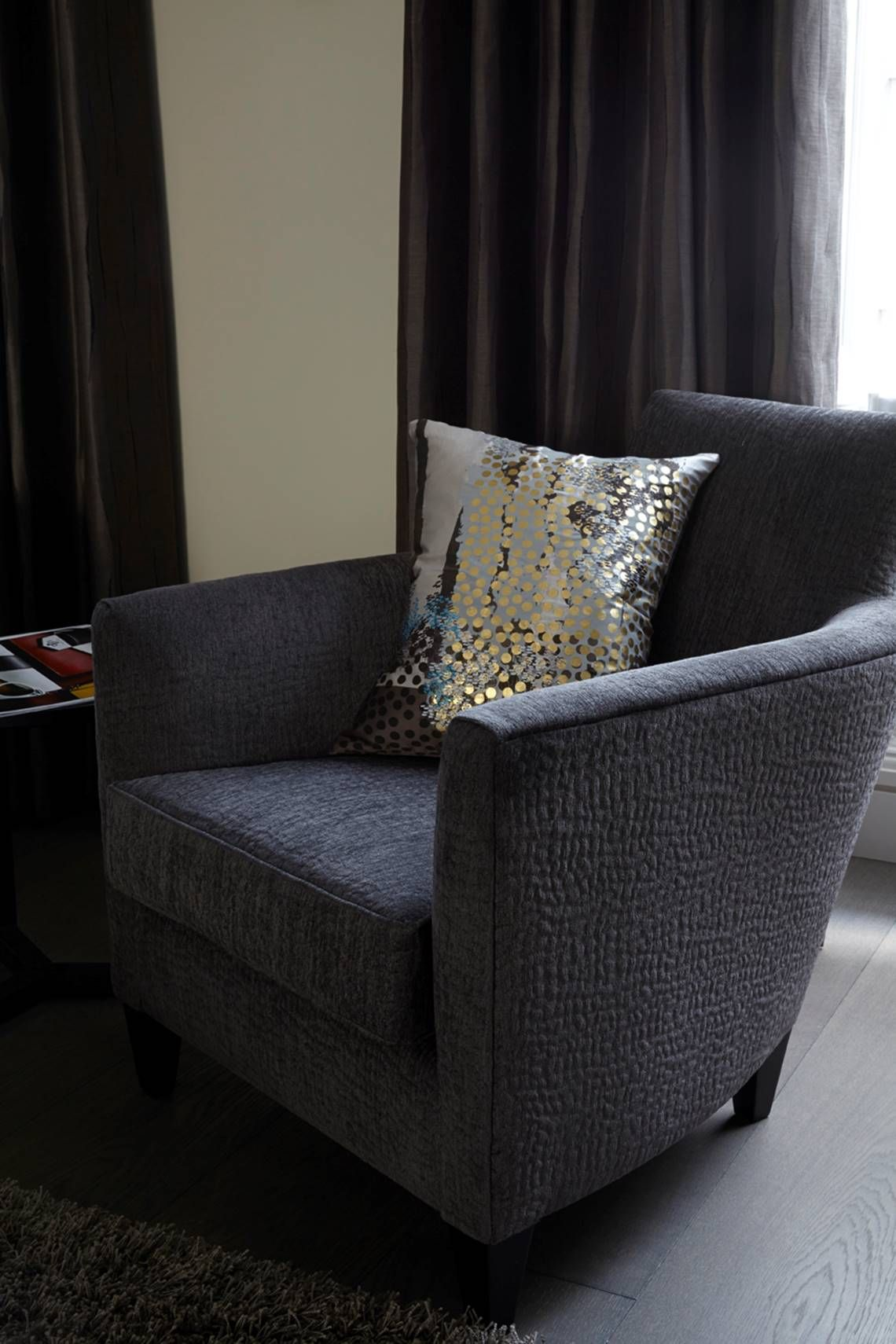 Armchair With A Single Colourful Cushion To Pick Out The Feature Colours Of The  Room.