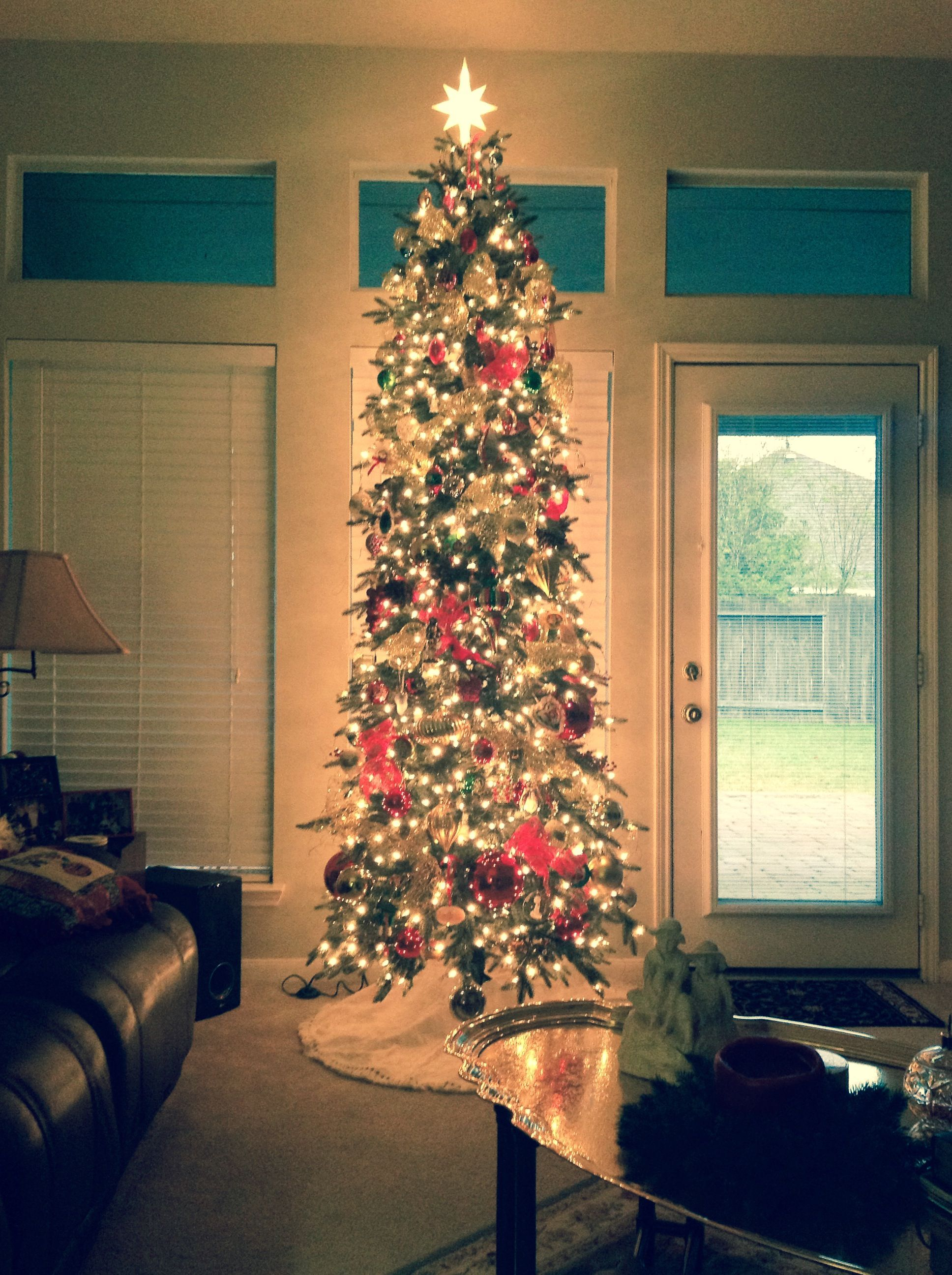 A tall narrow Christmas tree is perfect for those who want to maximize the beauty of their space.