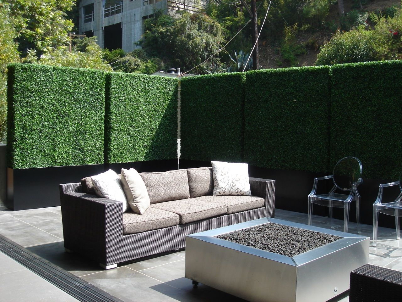 Create privacy on a patio or balcony with tall faux hedges for Creating privacy on patio