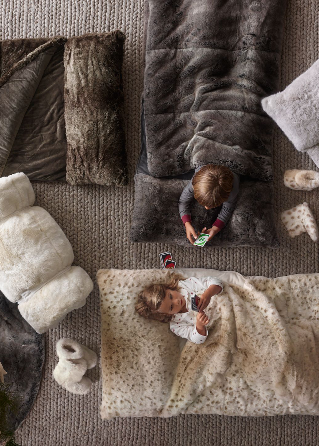d2d3acfec618 keep floor-crashers warm and cozy with snuggly faux fur sleeping bags.   rhbabyandchild