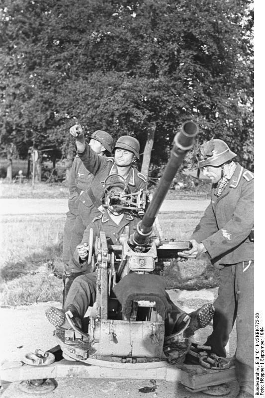Photo German 2 cm FlaK 30 anti aircraft gun during the Allied