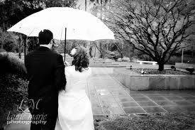 bride and groom w/umbrella