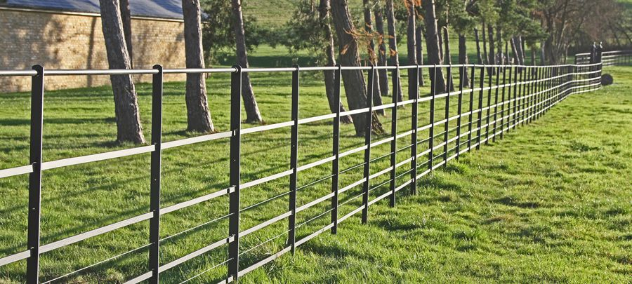Line Wire Situated In Standard Estate Fencing To Help Prevent Dogs