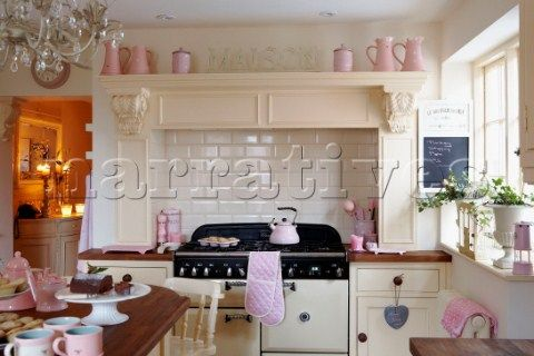 Sunlit cream kitchen with pink accessories Cream kitchen