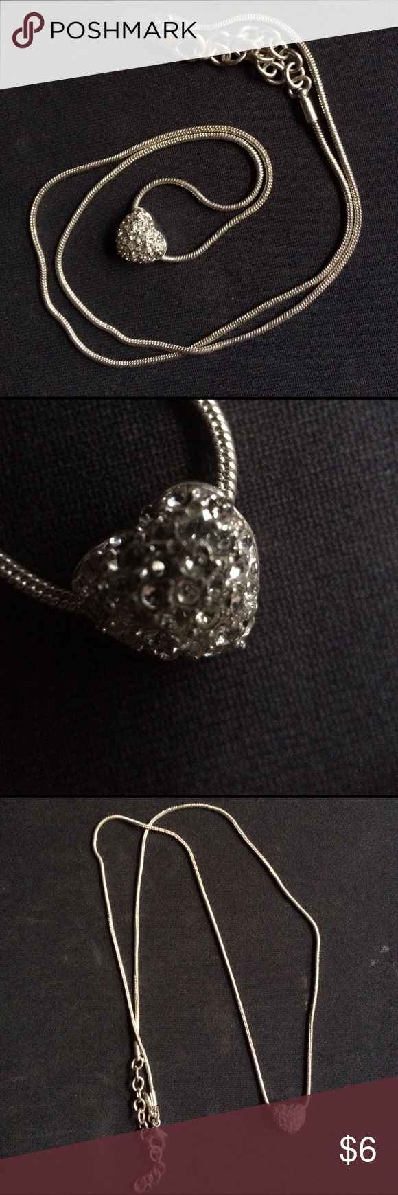 """Heart shaped faux diamond pendant silver necklace Vintage heart shaped pendant encrusted with faux diamonds on a thin silver chain, finished with a silver clasp. Adjustable on chain links. 9"""" when clasped at the last ring on the chain. I ship daily and am open to trades if you have one of my ISOs (listed in my closet). Will consider all offers! Vintage Jewelry Necklaces"""