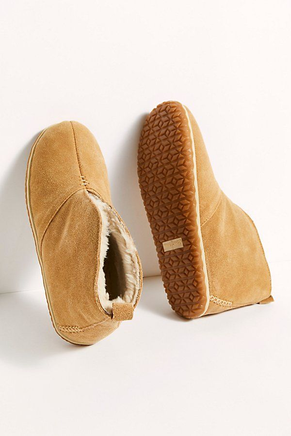 So comfy and soft, these suede slippers are featured in an ankle-high design with a plush and fluffy lining.* Pull-on design* Slit through center* Heel loop for easy on and off