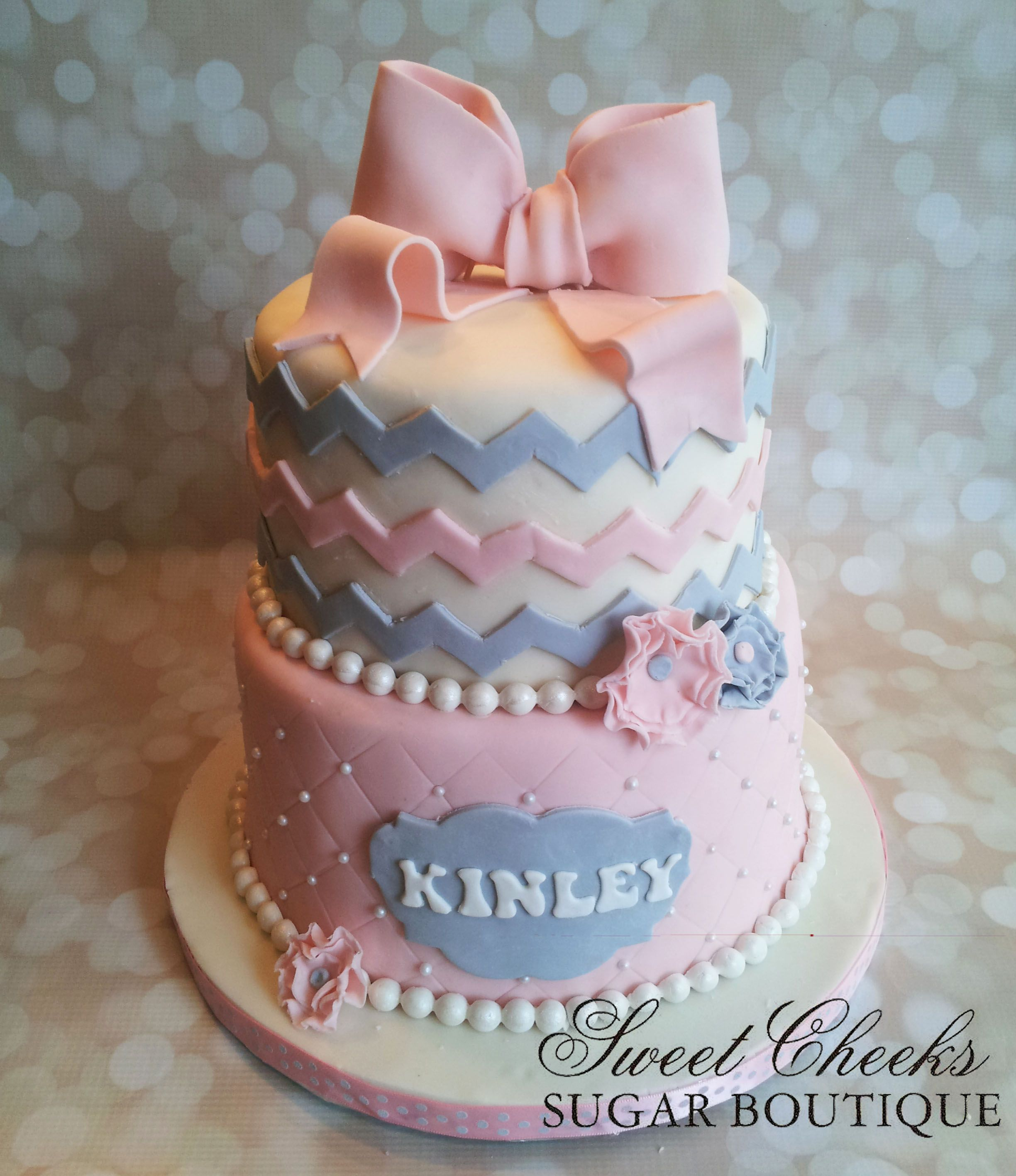 pink and gray chevron themed baby shower cake for baby kinley