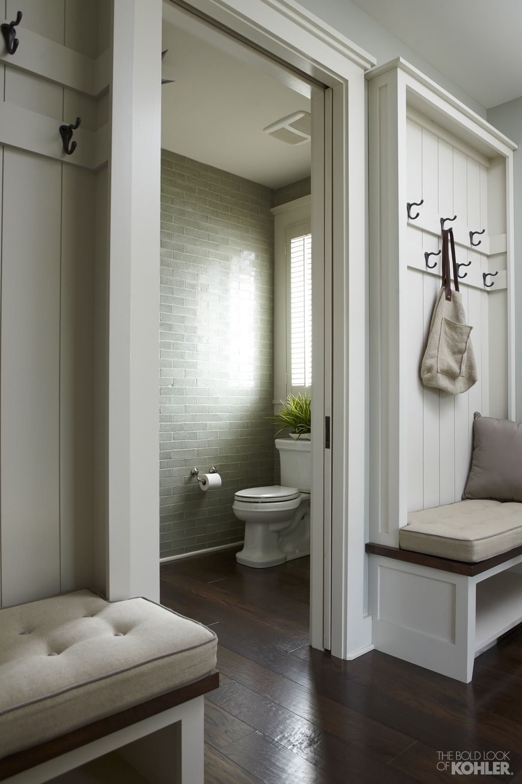The bold look of mudroom pocket doors and powder room bancroft toiletann sacks foundation brick tile in moss nashville farmhouse a convenient mudroom off the kitchen dailygadgetfo Gallery