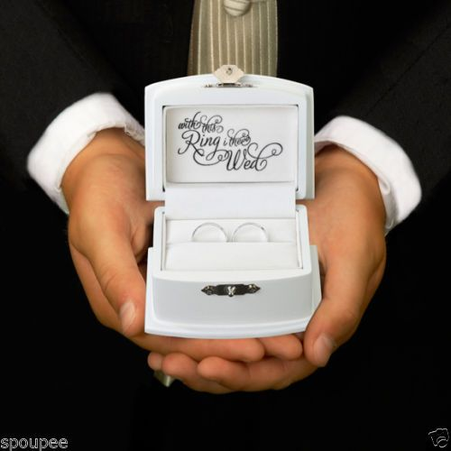 This ring bearer box will safely hold the rings as the ring bearer makes his way down the aisle. The ring box outside has the words \