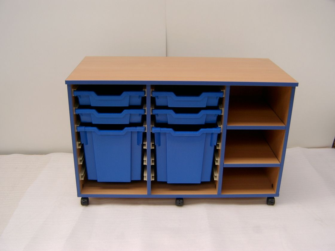 Bespoke classroom storage unit combining tray storage with shelf storage. Finished in Beech with Blue edging