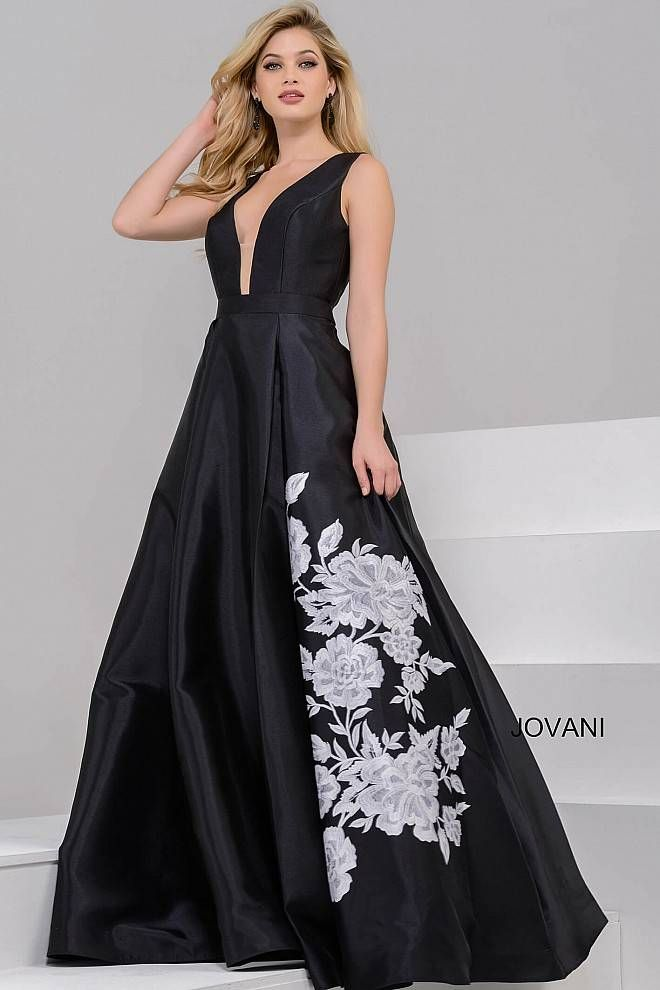 2e0ef380559 Gorgeous floor length black mikado ballgown with white flower embroidery on  the pleated skirt features sleeveless bodice with plunging v neckline and  open ...