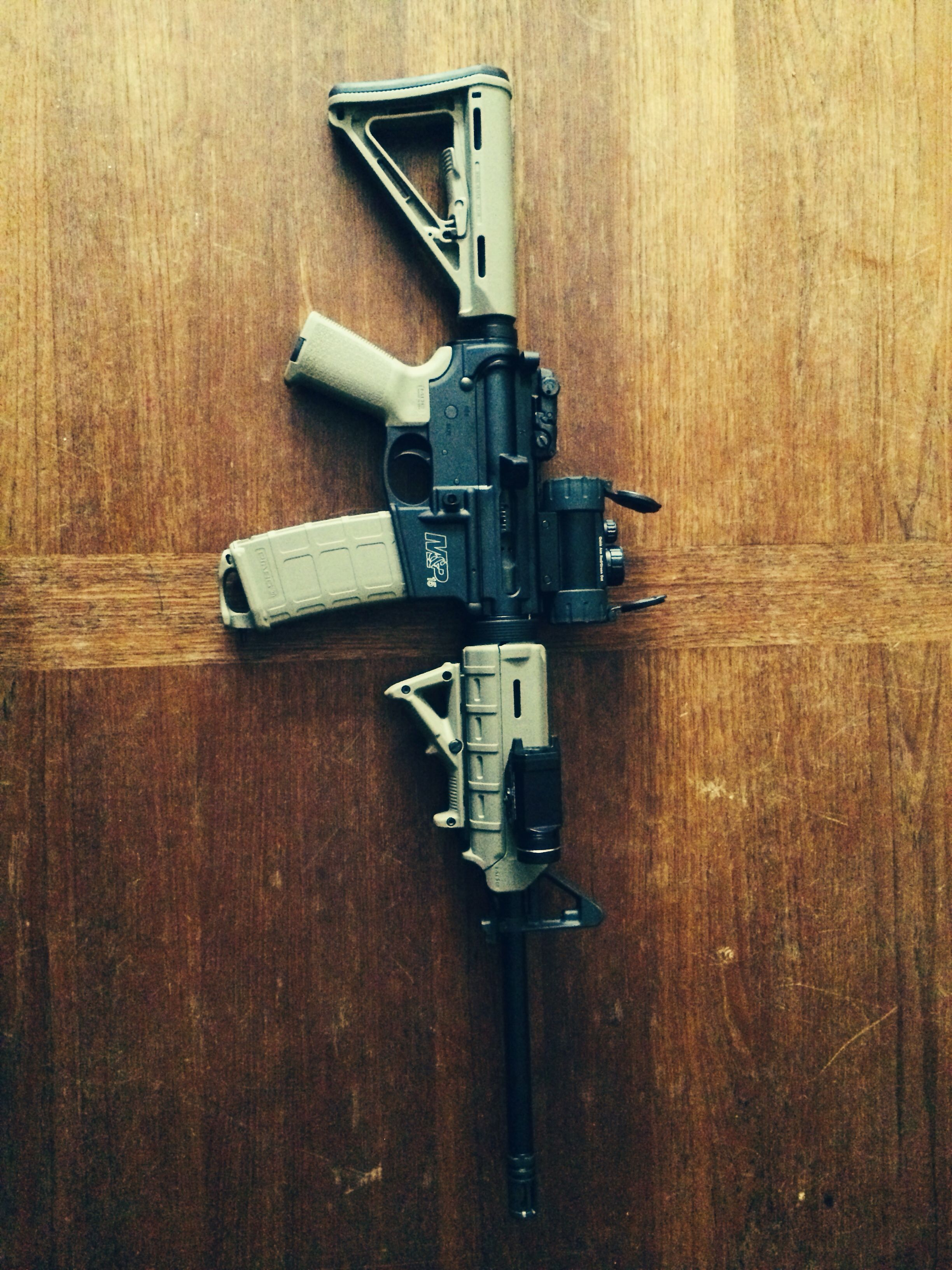 My AR 15 Smith and Wesson M&P 15 with FDE Magpul furniture UTG red