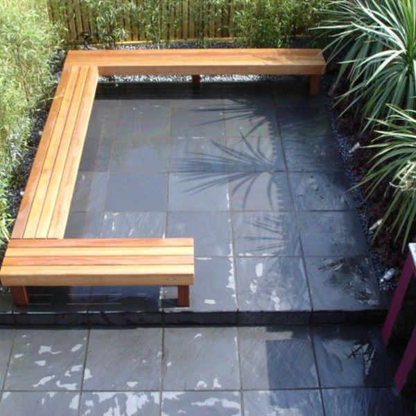 Love wooden bench l shaped seating on black paving in a for L shaped garden designs images