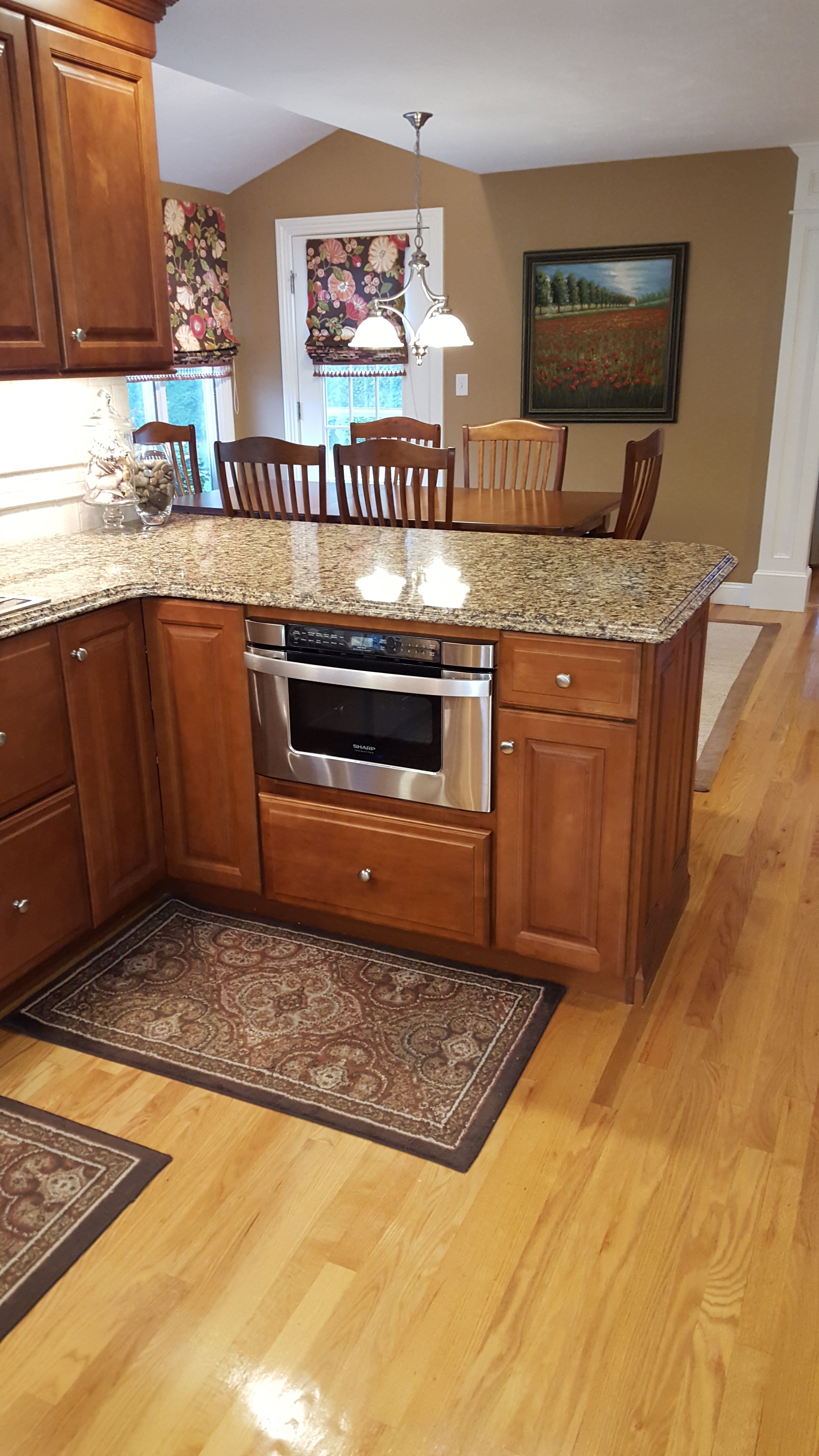 Diamond Cabinets, Sullivan Full Overlay Door Style, Maple In Harvest Stain.  Countertop Is Cambria Quartz, Color Is Canterbury With A Double Ogee Edge.