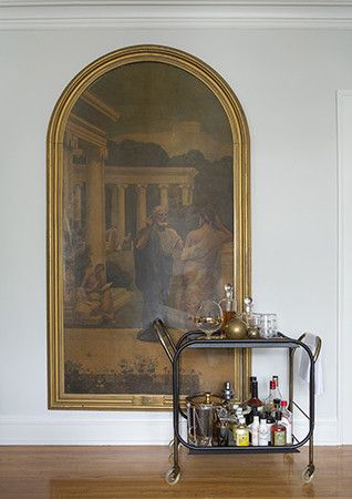 Part of a classical era–themed diptych behind a bar cart