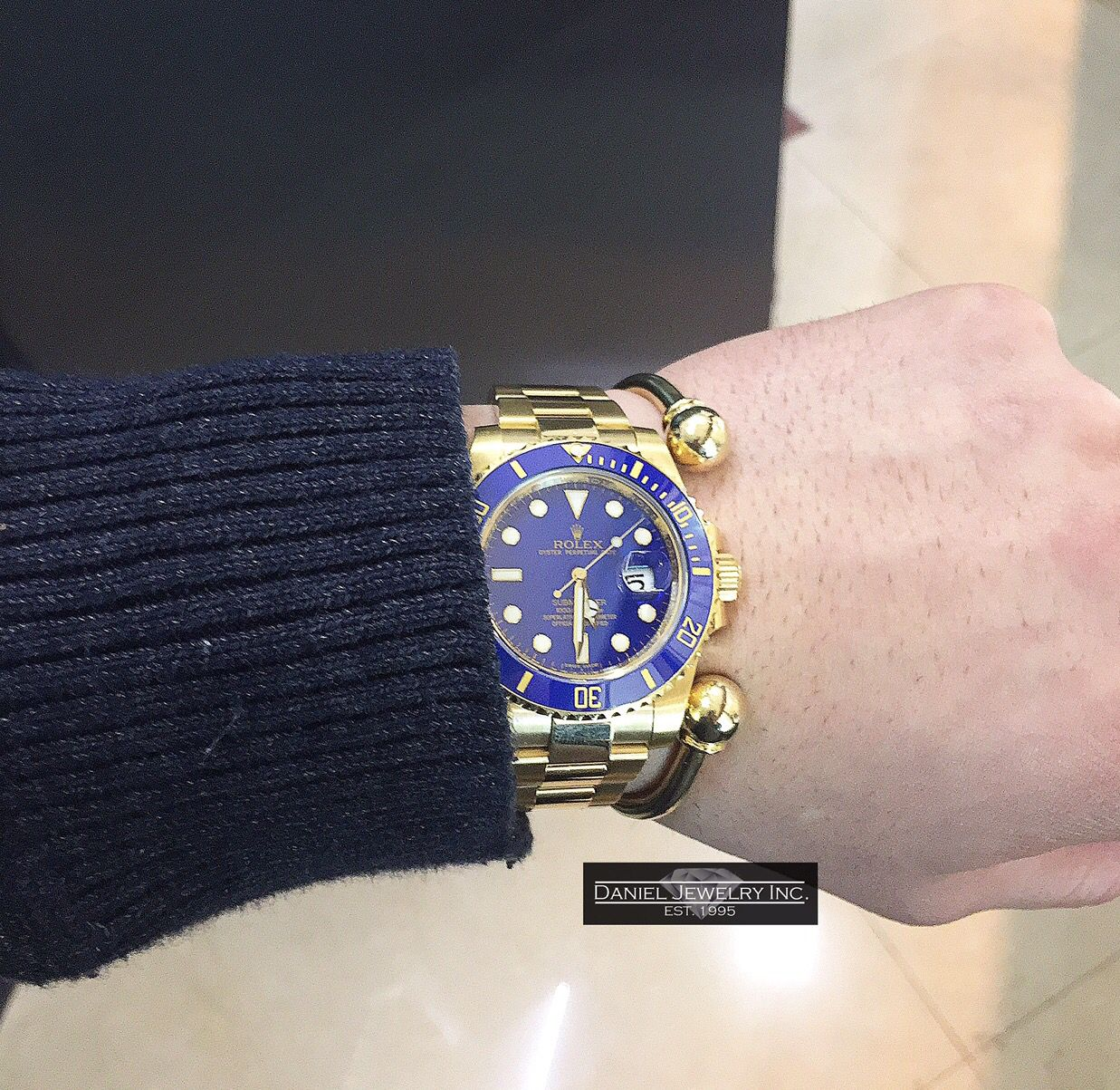 All gold everything.  All 18k gold Rolex Submariner.