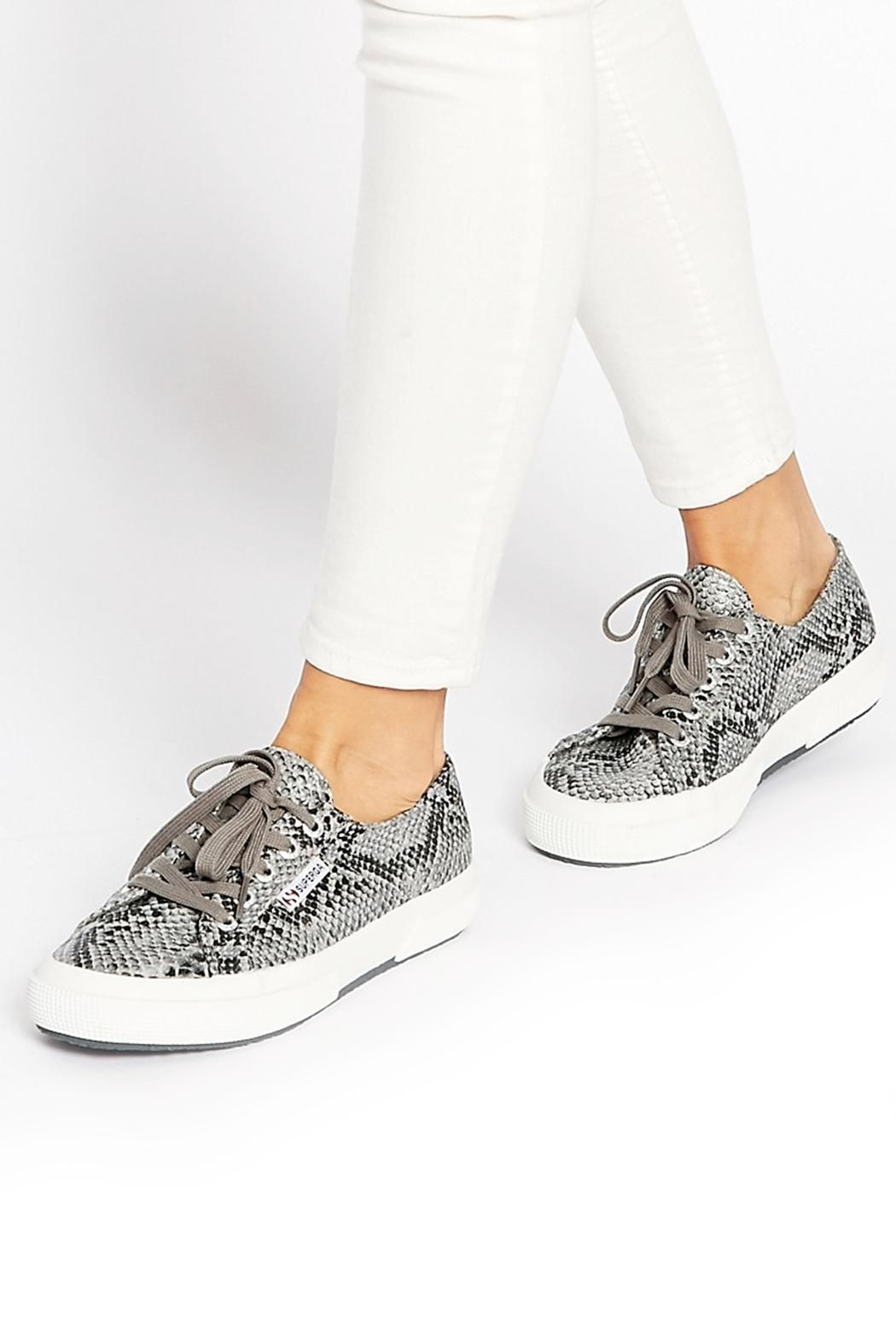 A classic low-top lace-up sneaker with a modern faux-leather snakeskin