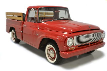 Red 1966 International pickup truck- yup just like mine cept mine didn't have the wood slats.