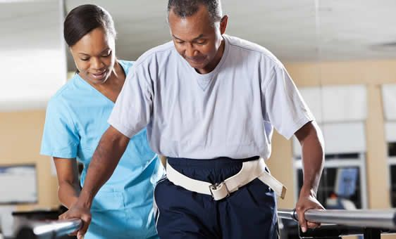 Physical Therapist helping rehabilitate a consumer Physical