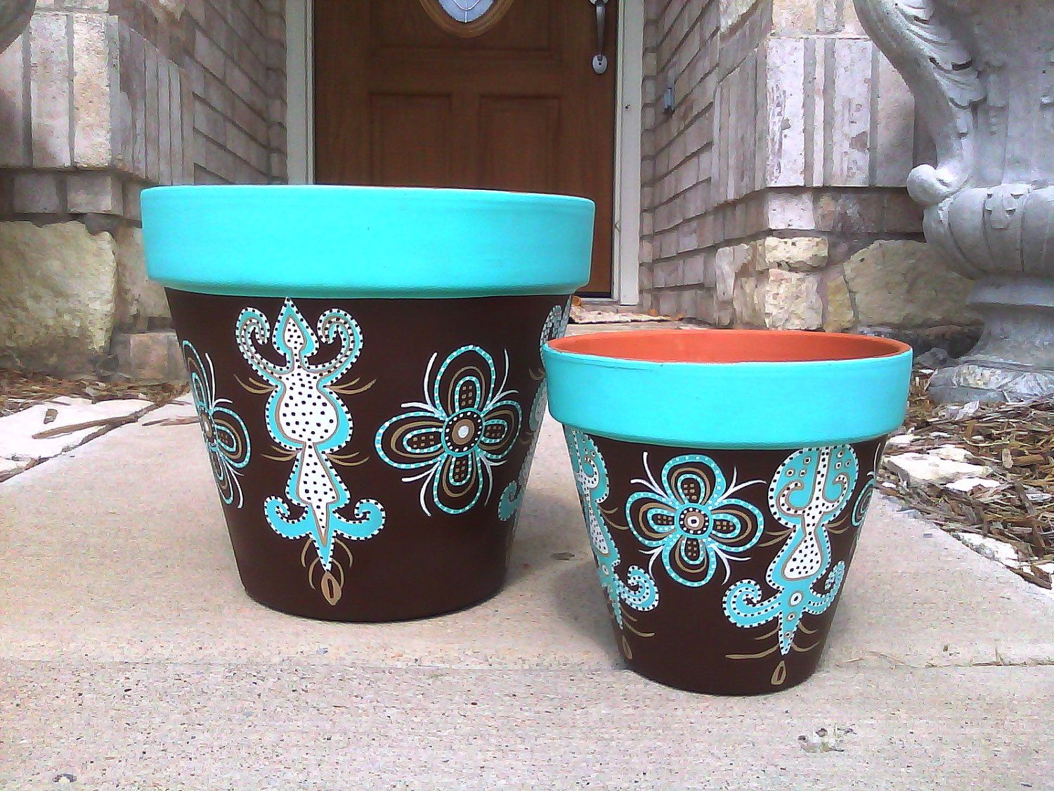 Hand painted flower pots, turquoise and brown. 75.00, via