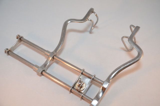 SOLD: This stainless steel Balfour abdominal retractor made by Haslam, USA is a beauty! It is a standard laparotomy wound retractor. The adjustable arms retract (wide open) to approximately 6 inches with the heavy duty, double-rod base measuring 9.25 inches in length. The overall height is approximately 7.25 inches. A third arm (not present) is able to be attached to the adjustable/ moving cross piece to allow abdominal wall retraction in 3 directions.