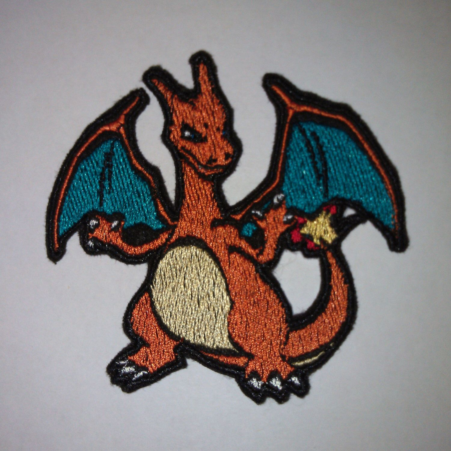 Charizard - Iron on patch - Shiny Metallic Embroidered.   Pokemon patch. by Critstitch on Etsy https://www.etsy.com/listing/201488446/charizard-iron-on-patch-shiny-metallic
