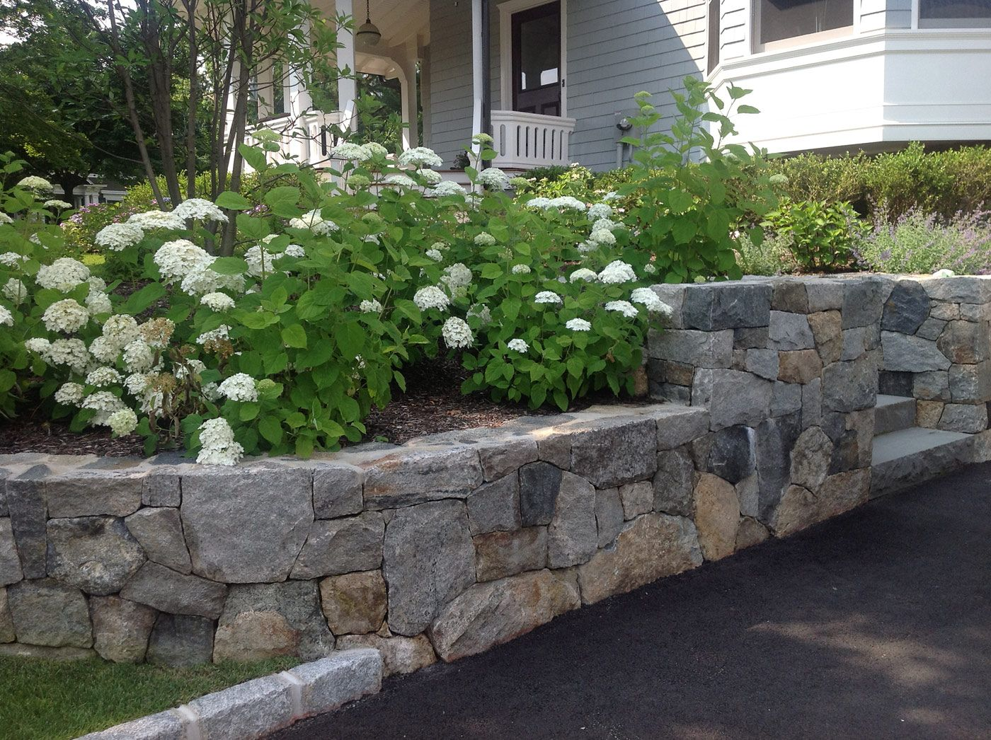 landscape design with retaining wall natural stone