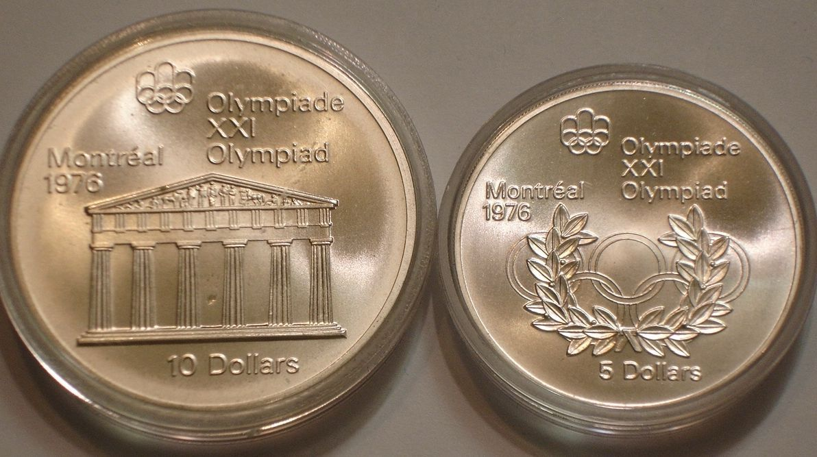 Item specifics     Grade:   Gem BU   Circulated/Uncirculated:   Uncirculated      1974 Silver $5 & $10 of Canada GEM BU 2+ oz SILVER Olympic Temple of Zeus & Ring  Price : $29.00  Ends on : 40 mins Order Now