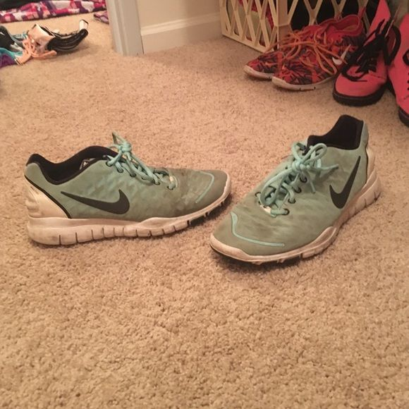 Nike free Used a lot. Obvious by the pictures. Stained from running through mud. Nike Shoes Athletic Shoes