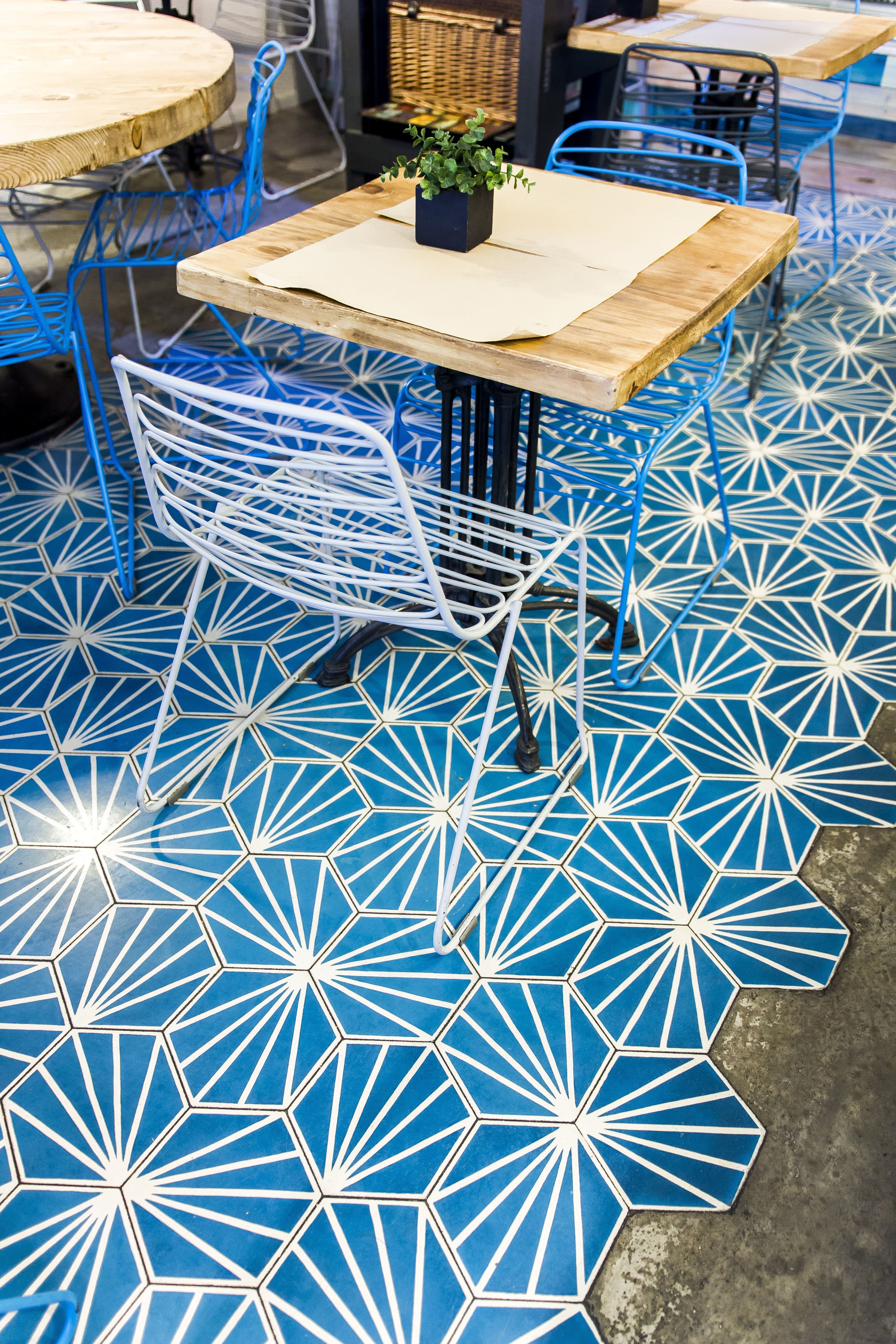 Blue and white hexagonal cement tile with geometric