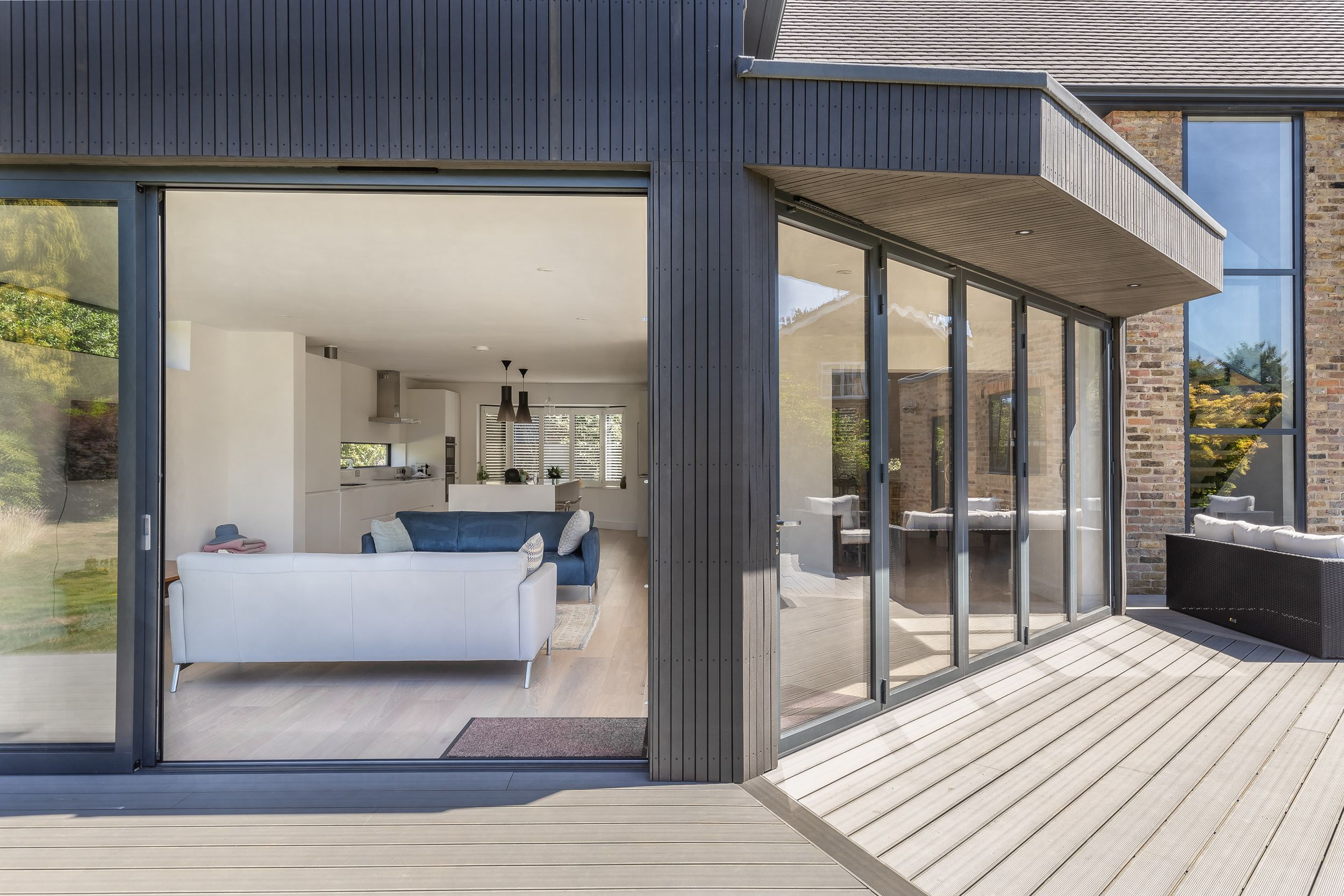 Angled Extension Facade With Flat Roof Overhang Open Plan Living Decking Timber Cladding Slidin Architecture Design Timber Cladding Construction Design