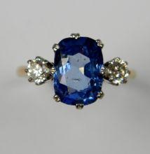 Bright Ceylon sapphire and diamond three stone (0589)