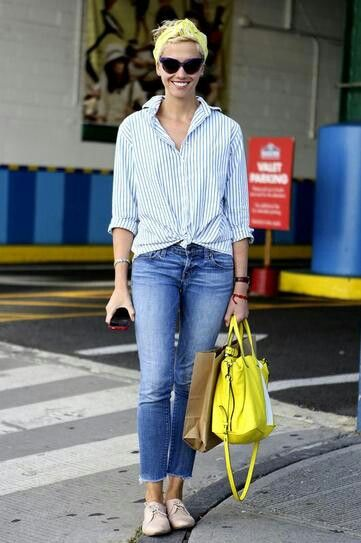 One surefire way to dress up a pair of boyfriend jeans is making sure all your accessories are significantly sharper than the typically slouchy pants. Prime example: a crisp button-up, a sleek pair of loafers, and a brightly colored, structured bag. The French countryside vibe of the cat-eye shades and headband don't hurt, either.  Photo: ImaxTree    Read more:http://www.stylecaster.com/how-to-style-boyfriend-jeans/#ixzz2xeCaAKgB