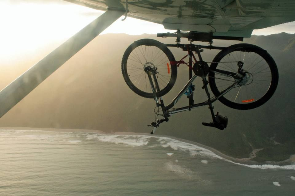 Amazing Mountain Bike Adventure South Island Nz This Is Mountain Bike Hanging Off Bottom Of Small Plane On Mountain Biking Adventure Bike Adventure Tourism
