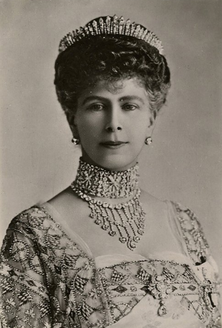 Queen Mary and the 'other' fringe tiara (Hannover Fringe Tiara); shorter at the front than the one worn by Queen Elizabeth/Princess Anne at their weddings.