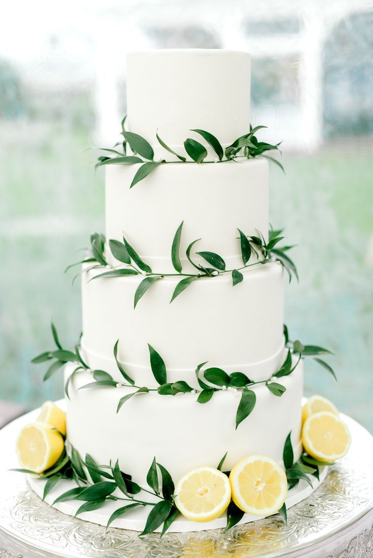 This minimal white wedding cake with lemon accents is so simple and elegant that