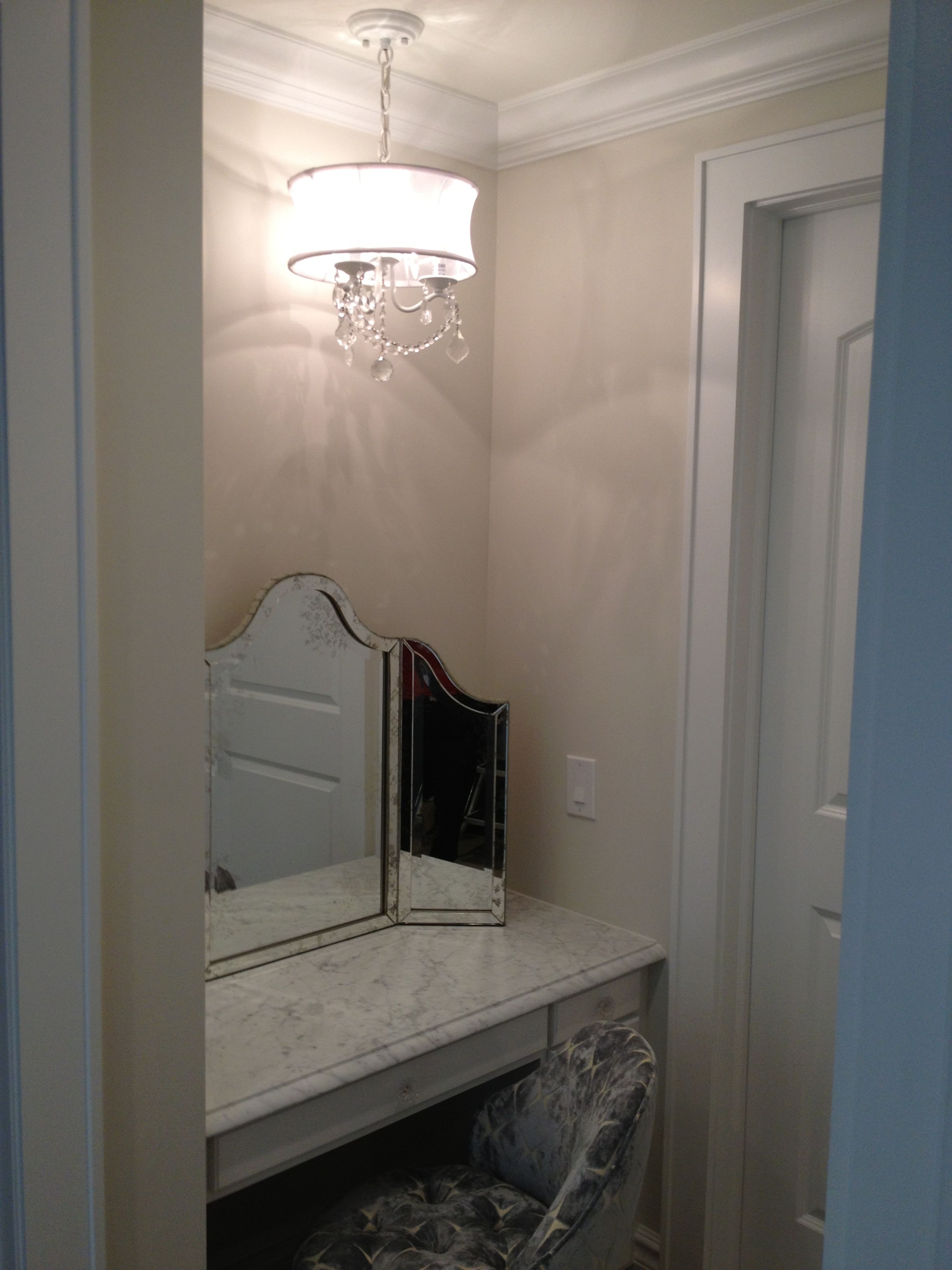 Here is the finished product!  Custom Vanity Area with antique mirror and custom vanity chair. Pretty chandelier above