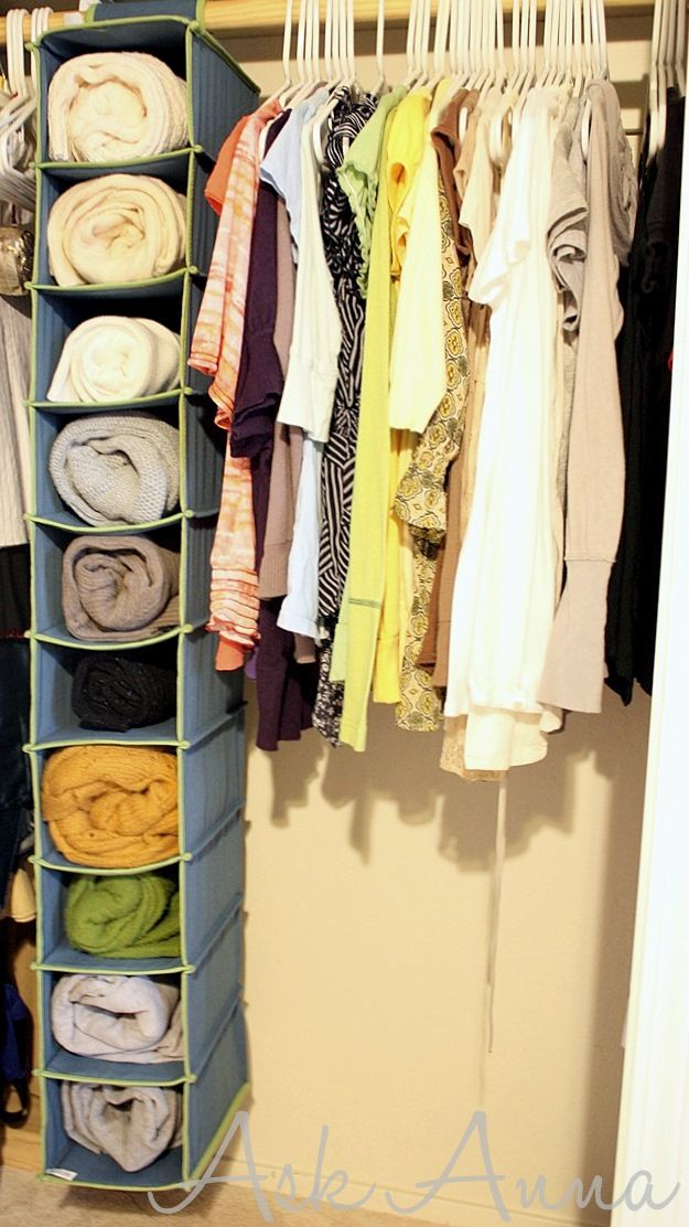 using a shoe organizer to store sweaters in the closet