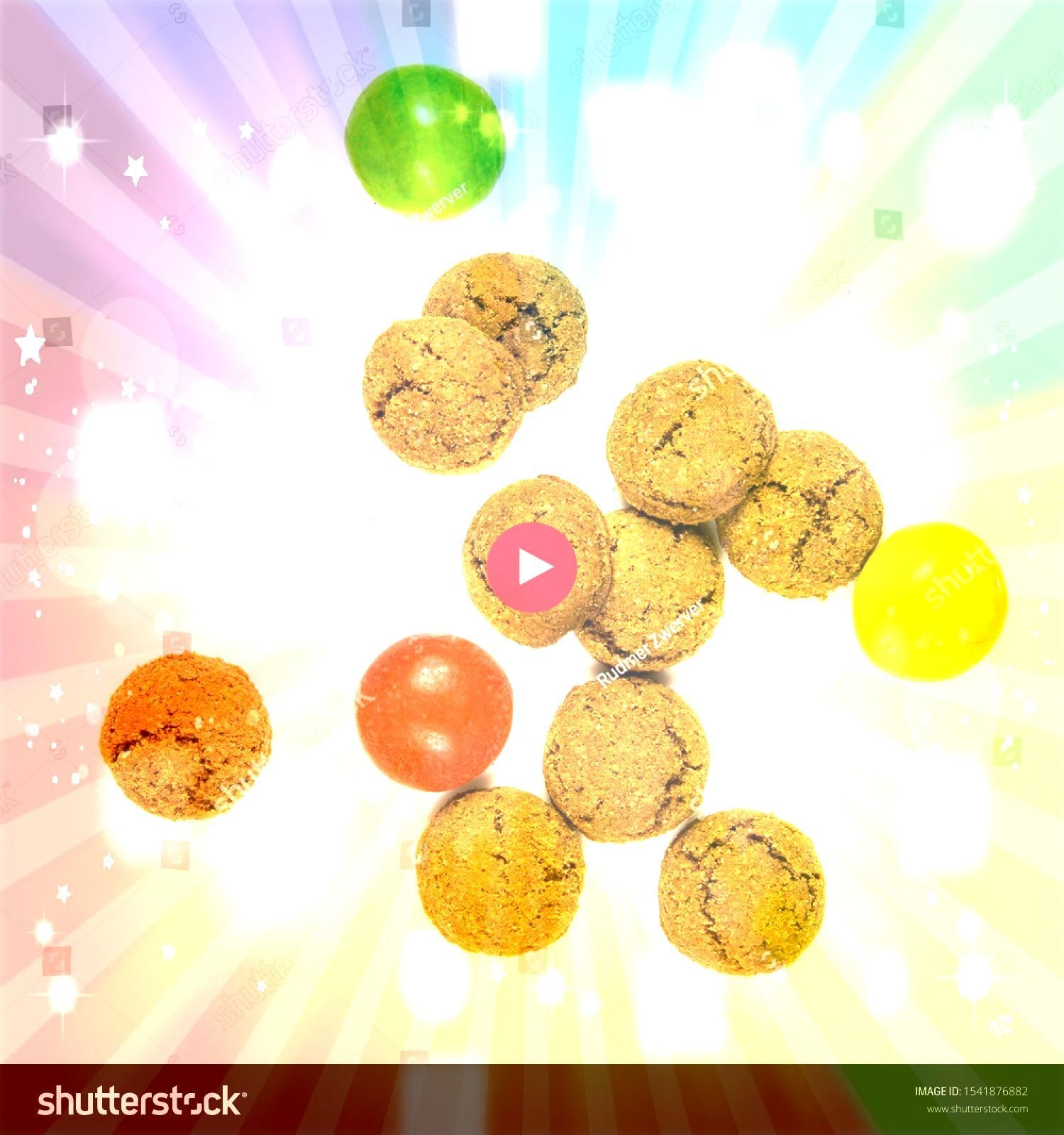 of scattered pepernoten cookies and sweets from above on white background for annual Sinterklaas holiday event in the Netherlands on december 5th Group of scattered peper...