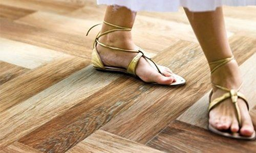 just love the Sandalwood Coconut tile from South Cypress - almost impossible to tell it's not real, and laying it herringbone style makes it look even more like real wood