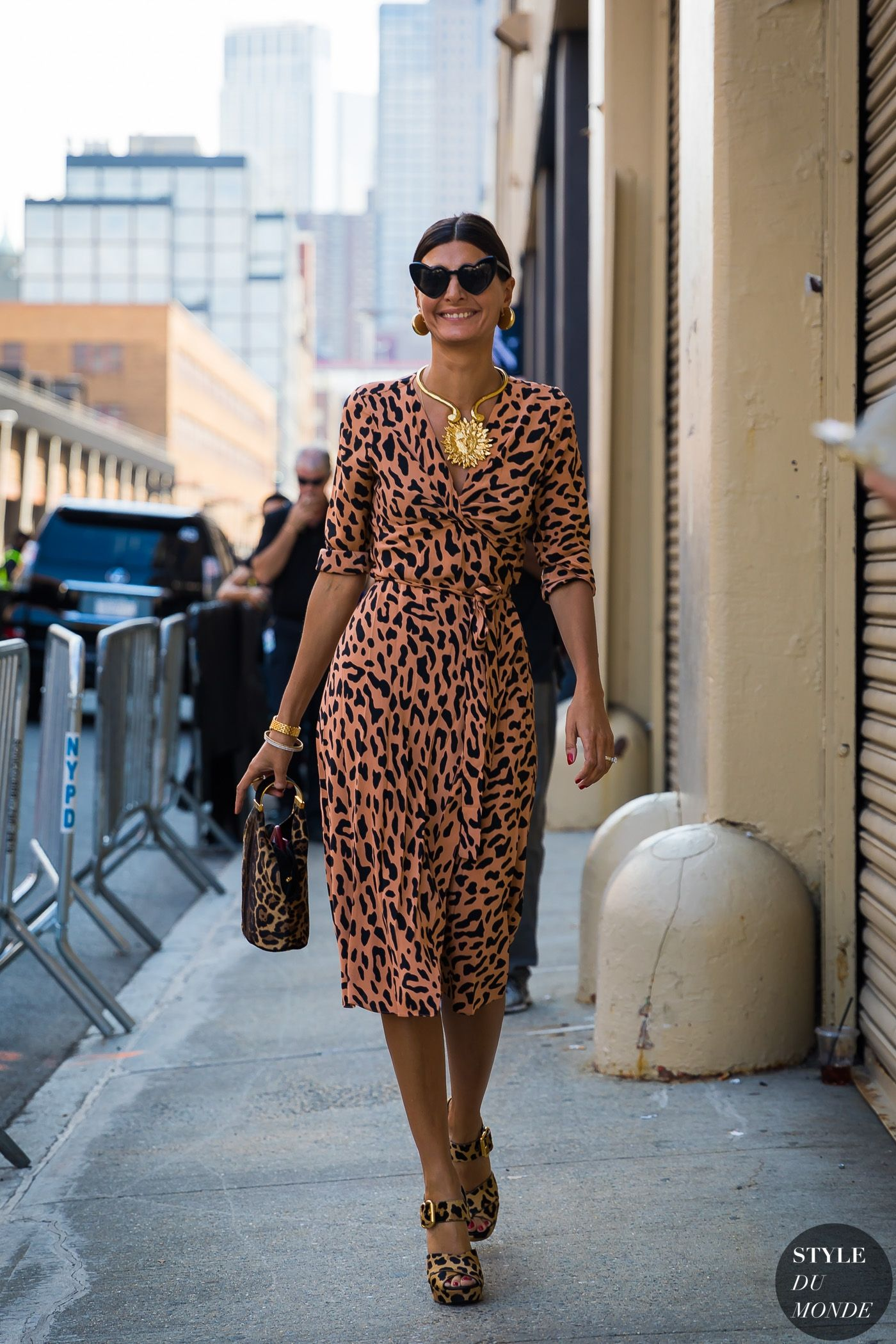 cdf1812f5af Giovanna Battaglia Englebert in DVF leopard print wrap dress.