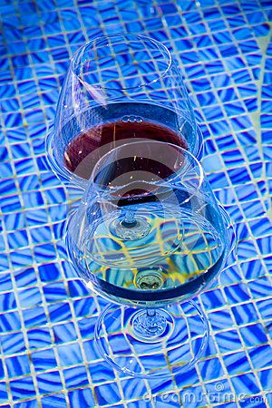 two wine glasses floating in pool - Floating Wine Glass