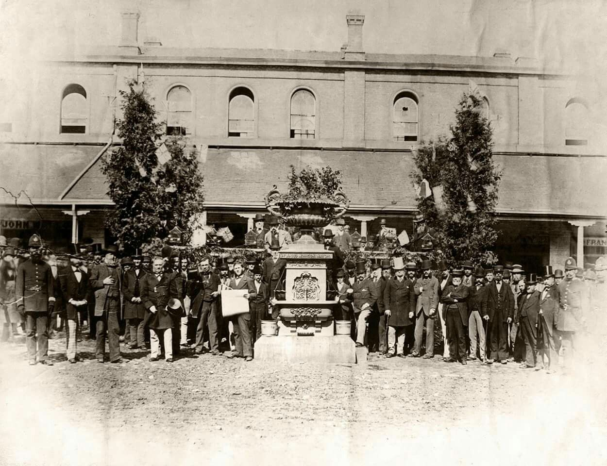 Fountain, St. Lawrence Market, in front of west side of south front of north market, unveiling, 1877. Fountain given to city by Mayor Angus Morrison, later moved to Ferry Docks. Photographer unknown. - Courtesy of the Toronto Public Library.